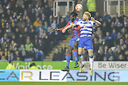 Crystal Palace striker Emmanuel Adebayor and Reading FC defender Paul McShane jump for the ball during the The FA Cup Quarter Final match between Reading and Crystal Palace at the Madejski Stadium, Reading, England on 11 March 2016. Photo by Mark Davies.