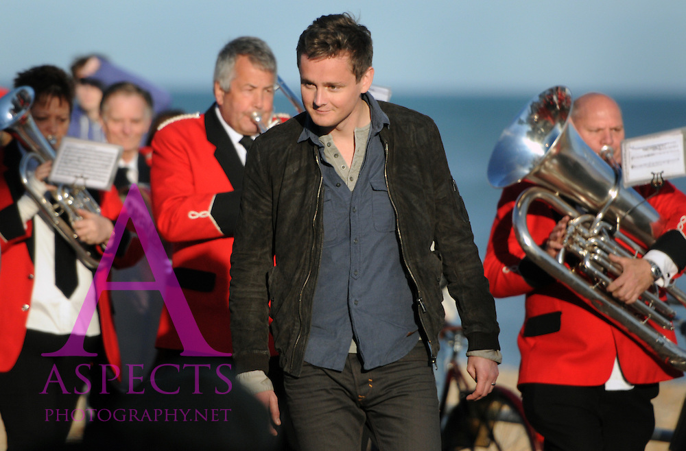 Keane filming Sovereign Light Cafe at Bexhill