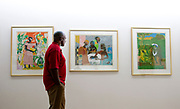 THIS IS FOR SOUTHPARK MAGAZINE. Harvey Gantt has an assortment of prints from a Romare Bearden series. PHOTO BY WENDY YANG