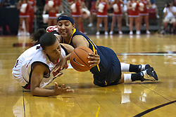 1 April 2010: Shala Jackson and Layshia Clarendon dive for a free ball. The Redbirds of Illinois State are dropped by the Golden Bears of California 61-45 in the semi-final round of the 2010 Women's National Invitational Tournament (WNIT) on Doug Collins Court inside Redbird Arena at Normal Illinois.