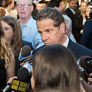 Governor Cuomo of New York talks to reporters at opening of Moynihan Train Hall Penn Station.
