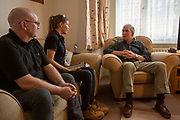 Dayna & Dave  discuss the process with the client. Q-bot, underfloor insulation reducing carbon emissions potentially for 12 million households in the UK.   Q-Bot allows under-floor insulation to be installed at a much lower cost and without the disruption of existing methods by using a small robot that goes under the floor instead of having to take the floor up. © Andy Aitchison/ Ashden