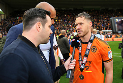 Free to use courtesy of Sky Bet - Barry Douglas of Wolverhampton Wanderers celebrate after lifting the Sky Bet Championship 2017/18 league trophy - Mandatory by-line: Matt McNulty/JMP - 28/04/2018 - FOOTBALL - Molineux - Wolverhampton, England - Wolverhampton Wanderers v Sheffield Wednesday - Sky Bet Championship