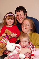 Scottish Sun Santa at the home of Sally & Adam Gray with baby Oliver and daughter Alyssa, at home in Galashiels..©2010 Michael Schofield. All Rights Reserved.