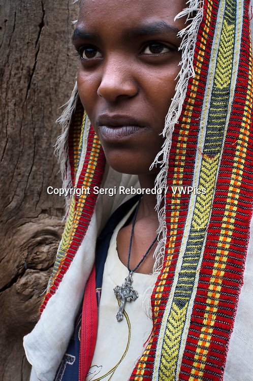 The temple of Yeha in Tigray, museum, Ethiopia. Portrait of a villager in Yeha. In Yeha, in addition to the visits to the ruins, it is also possible to visit some of the potters. Yeha is situated in the northern hilly section of the Tigray region. Although today this small settlement survives as a shanty town, it was once a site of great pre-Axumite civilization. Believed to be the first capital of Ethiopia, Yeha was first discovered at first in a complex archaeological excavation around a courtyard of 20 C.