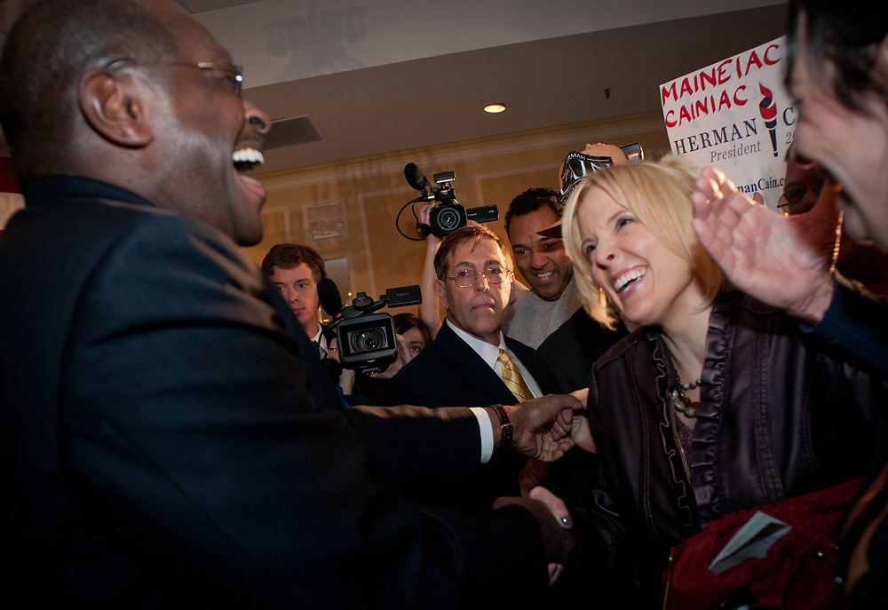 Presidential hopeful Herman Cain jokes around with a female supporter as greets voters after speaking at a  campaign Rally in the Radisson Hotel in Nashua, NH.