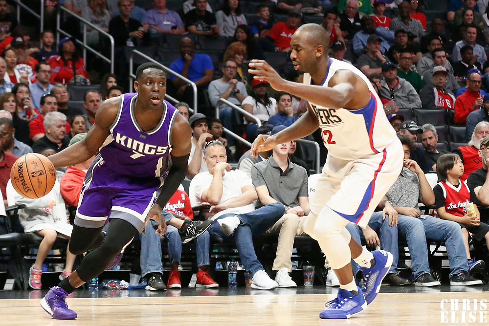26 March 2016: Sacramento Kings guard Darren Collison (7) drives past LA Clippers forward Luc Mbah a Moute (12) during the Sacramento Kings 98-97 victory over the Los Angeles Clippers, at the Staples Center, Los Angeles, California, USA.