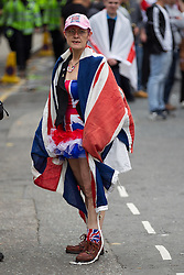 © Licensed to London News Pictures . 07/09/2013 . London , UK . An EDL supporter dressed up in Union Flag clothing . The EDL hold a march and demonstration in London today (Saturday 7th September 2013) . Photo credit : Joel Goodman/LNP