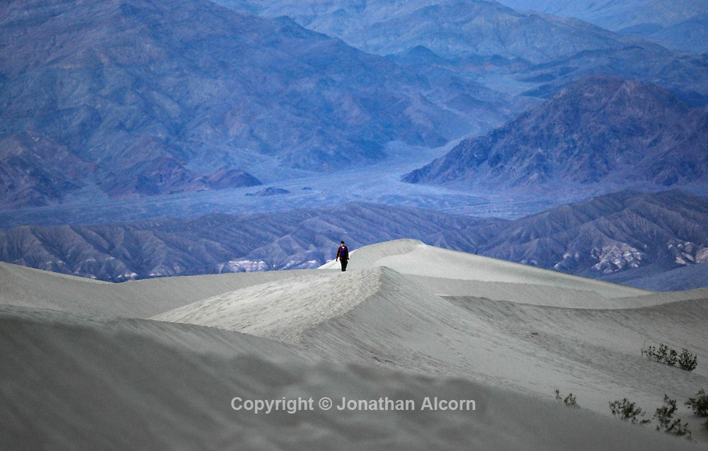 A woman hikes at the Eureka Sand Dunes on January 10, 2015 in Death Valley, California
