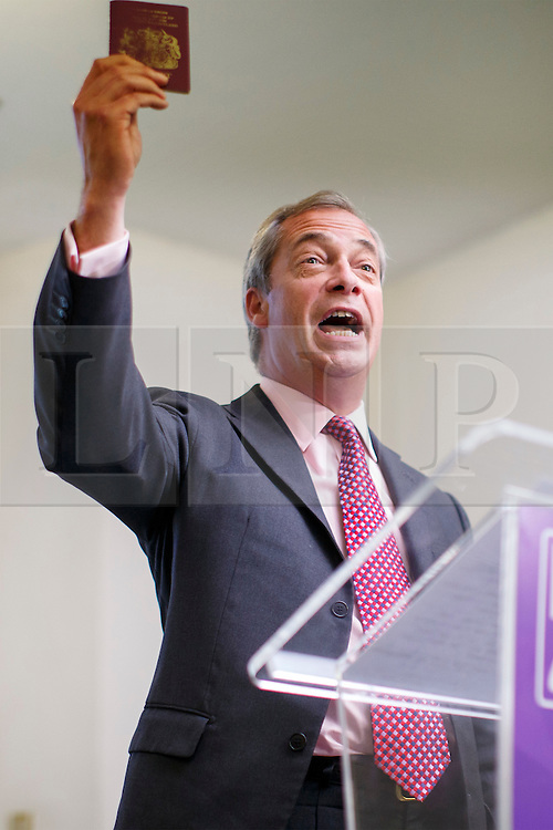© Licensed to London News Pictures. 22/06/2016. London, UK. UKIP Leader NIGEL FARAGE shows his passport whilst making his final speech of the EU Referendum Campaign on Wednesday, 22 June 2016 at Emmanuel Centre in London ahead of the EU Referendum. Photo credit: Tolga Akmen/LNP