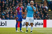 Crystal Palace defender Patrick van Aanholt (3) and Manchester City forward Sergio Aguero (10) during the Premier League match between Crystal Palace and Manchester City at Selhurst Park, London, England on 14 April 2019.
