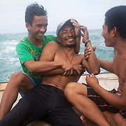 Moments of time-off inbetween catches.Joseph is 17 and works like his father did on the sea as a fisherman. The catch of the day is hauled in by the entire crew to be sorted out on deck and taken straight to the market in Hinigaran. The catch that day made the crew $12.00 each( Captain Joan $24.00) One day a week Joseph goes to Alternative Learning schooling provided by Quidan-Kaisahan.  Quidan-Kaisahan is a charity working in Negros Occidental in the Philippines. Their aim is to keep children out of work to secure them education.