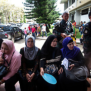 MARAWI, PHILIPPINES - JUNE 4: Residents waits for their family in Provincial Capitol Complex while government troops are trying to recover families who are left behind in the outskirts of Marawi City in southern Philippines, June 4, 2017. Philippine Arm Forces and Marines continue to advance their positions as more soldiers reinforce to fight the Maute group in Marawi City, Mindanao, Philippines. (Photo: Richard Atrero de Guzman/ANADOLU Agency)
