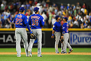 Apr. 29 2011; Phoenix, AZ, USA; Chicago Cubs infielder Carlos Pena (22) and teammate Aramis Ramirez (16) react on the field after defeating the Arizona Diamondbacks 4-2 in the ninth inning at Chase Field.  Mandatory Credit: Jennifer Stewart-US PRESSWIRE..