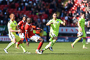 Charlton Athletic midfielder Alou Diarra (12) fights for the ball in midfield with Brighton central midfielder, Beram Kayal (7) during the Sky Bet Championship match between Charlton Athletic and Brighton and Hove Albion at The Valley, London, England on 23 April 2016. Photo by David Charbit.