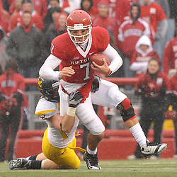 Dec 5, 2009; Piscataway, NJ, USA; Rutgers quarterback Tom Savage (7) is tackled during first half NCAA Big East college football action between Rutgers and West Virginia at Rutgers Stadium.