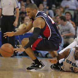 05 November 2008: Atlanta Hawks guard Acie Law (4) fights with New Orleans Hornets forward James Posey (41) over a loose ball during a 87-79 victory by the Atlanta Hawks over the New Orleans Hornets at the New Orleans Arena in New Orleans, LA..