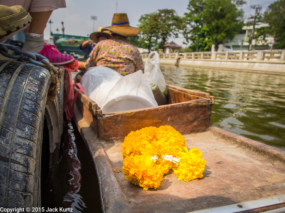12 FEBRUARY 2015 - BANGKOK, THAILAND:  A a garland of marigold flowers on the prow of a vendor's canoe at the new floating market opened on Khlong Phadung Krung Kasem, a 5.5 kilometre long canal dug as a moat around Bangkok in the 1850s. The floating market opened at the north end of the canal near Government House, which is the office of the Prime Minister. The floating market was the idea of Thai Prime Minister General Prayuth Chan-ocha. The market will be open until March 1.   PHOTO BY JACK KURTZ