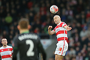 Doncaster Rovers midfielder Paul Keegan wins the header during the The FA Cup third round match between Doncaster Rovers and Stoke City at the Keepmoat Stadium, Doncaster, England on 9 January 2016. Photo by Simon Davies.