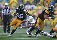 September 3, 2011: Iowa Hawkeyes running back Mika'il McCall (25) tries to avoid Tennessee Tech Golden Eagles defensive tackle LaDarrius Verge (98) during the first half of the game between the Tennessee Tech Golden Eagles and the Iowa Hawkeyes at Kinnick Stadium in Iowa City, Iowa on Saturday, September 3, 2011. Iowa defeated Tennessee Tech 34-7 in a game stopped at one point due to lightning and rain.