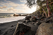 Waves crash against the rocks on Kahena Beach, Big Island, HI.