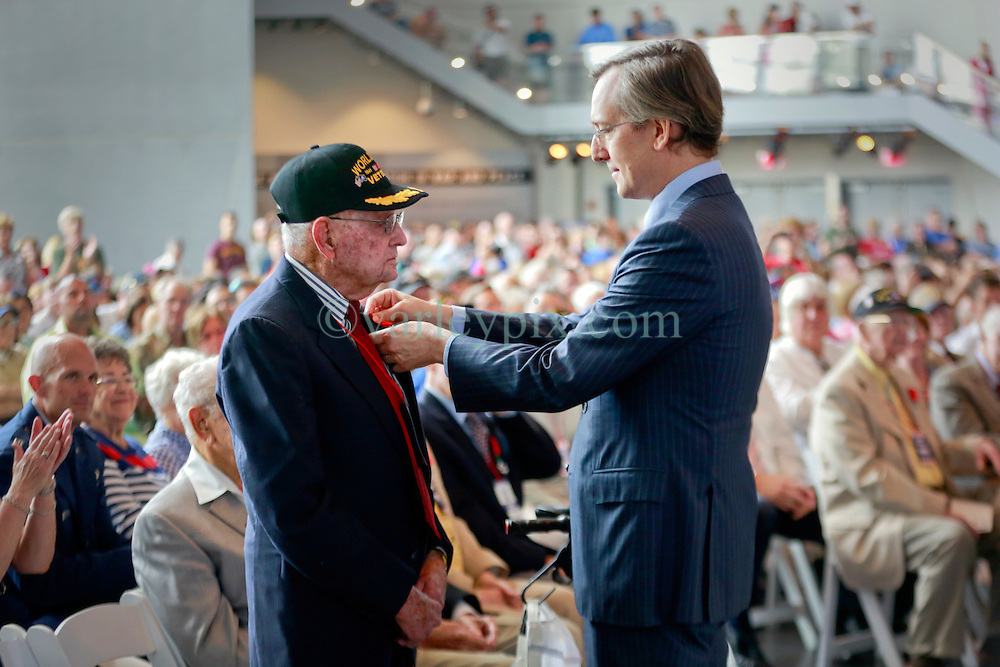 06 June 2014. The National WWII Museum, New Orleans, Lousiana. <br /> WWII veteran Corporal Herman Torres, 2nd Armored Division, 82nd Recon is honored with the French Legion of Honor medal by French Consul General, Claude Brunet..<br /> Photo; Charlie Varley/varleypix.com
