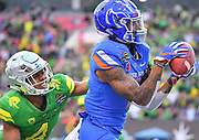 Dec 16, 2017; Las Vegas, NV, USA;  Boise State Broncos wide receiver Cedrick Wilson (1) catches a deep ball against Oregon Ducks cornerback Thomas Graham Jr. (4) late in the fourth quarter during their game at the 26th Las Vegas Bowl at Sam Boyd Stadium. Boise State won 38-28.  Photo Credit: Sam Wasson for the Portland Tribune
