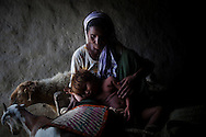 Anwar Bibi, 40, sits in her hut with her child, Sassi, 3, on July 15, 2011, in Basti Dirkhan Wala, Pakistan. Anwar struggles to provide for her children, as her husband is a drug-addict who uses what little money the family has to cater his addiction. According to UN reports, hundreds of thousands of children in Pakistan suffer from severe-acute-malnutrition, with 15.1% of children experiencing acute malnutrition. Child malnutrition has breached emergency levels in Pakistan's Sindh province, after monsoon floods devastated the country's poorest region for a second year. Extreme poverty, poor diet and health, exposure to disease, and inadequate sanitation and hygiene annually produce alarming levels of malnutrition amongst children, but the floods have increasingly endangered an already vulnerable population. (Photo by Warrick Page)