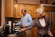 Former Merrill Lynch executive James A. Brown and his wife Nancy make a late breakfast for themselves at their Santa Fe New Mexico home on October 15, 2010...Credit: Steven St. John for The Wall Street Journal.ENRON