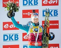 Second placed MAKARAINEN Kaisa (FIN) celebrates at medal ceremony after the Women 10 km Pursuit at day 3 of IBU Biathlon World Cup 2014/2015 Pokljuka, on December 20, 2014 in Rudno polje, Pokljuka, Slovenia. Photo by Vid Ponikvar / Sportida