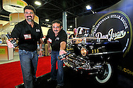 Ansa Foods, Inc Vice-President David Salazar and Chef Juan Cruz Anon offer Don Juan Argentinian Steak Sauce to visitors at the International Food and Beverage trade show at the Miami Beach Convention Center on Tuesday, September 25, 2012