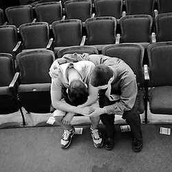 Sharing a quite moment after the Good Friday service at Virginia Tech University, Houston Yo (left) and David Chinn (right) quietly pray together after Burress Hall had cleared of service attendees. Houston and David were strangers before the service started, but found each other just as the service let out. Each came away from the shared prayer with a smile, as they headed out of the empty auditorium and into the crisp morning air.