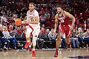 FAYETTEVILLE, AR - MARCH 9:  Daniel Gafford #10 of the Arkansas Razorbacks dribbles the ball down the court ahead of Galin Smith #30 of the Alabama Crimson Tide at Bud Walton Arena on March 9, 2019 in Fayetteville, Arkansas.  The Razorbacks defeated the Crimson Tide 82-70.  (Photo by Wesley Hitt/Getty Images) *** Local Caption *** Daniel Gafford; Galin Smith