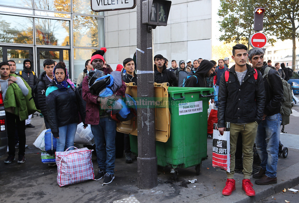 """Migrants stand in street near the Jaures and Stalingrad metro stations, in northern Paris, France, on October 31, 2016, during a police operation aiming at a future evacuation of a migrant camp. An operation of """"administrative control"""" was underway on early October 31 in the Jaures/Stalingrad quarter before a future evacuation, whose date has not yet been set, according to a police source. The makeshift camp on the outskirts of the 10th and 19th arrondissements in the north of the capital numbers today 2,500 people, according to the City of Paris Photo by Somer/ABACAPRESS.COM"""