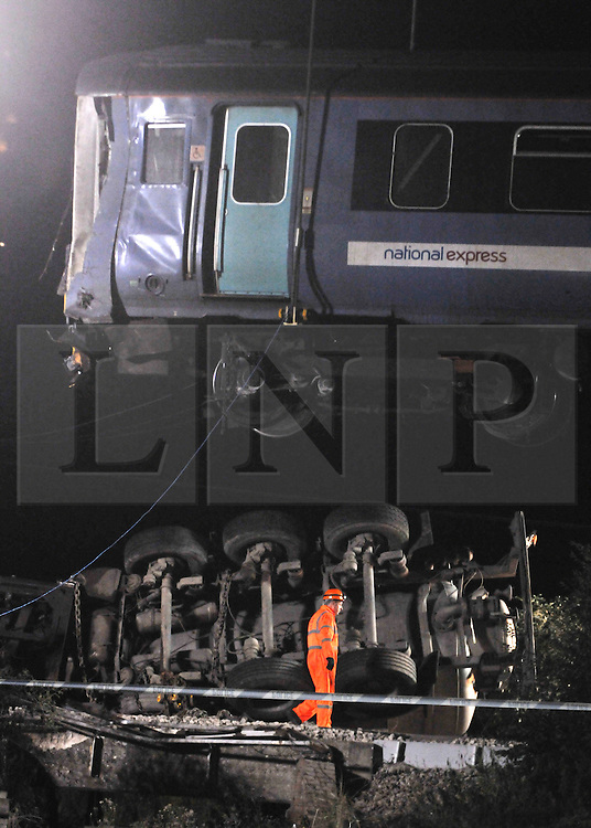 FILE PICTURE © under license to London News Pictures. 26/11/2010 .The scene of the crash. A lorry driver who drove on to a level crossing and caused a train crash was given a 15-month jail term today and banned from driving for three years. Arvydas Bartasius admitted endangering the safety of rail passengers during a hearing at Ipswich Crown Court. A judge heard that Bartasius drove on to a level crossing near Sudbury, Suffolk, in August and a passenger train travelling at 50mph hit his sewage tanker, leaving several people injured. No one was killed. Picture credit should read: Stephen Simpson/LNP