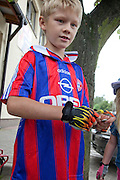 Healthy Polish boy age 8 wearing fingerless bicycle gloves. Rzeczyca Central Poland