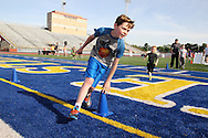 Jacob Reedy, 12, of Maryville, Tennessee practices the 3-cone drill during the All Pro Dad Father & Kids NFL Experience at Welcome Stadium, Saturday, June 18, 2016.
