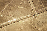 Aerial view of the spider shape. The Nazca Lines are a group of very large geoglyphs formed by depressions or shallow incisions made in the soil of the Nazca Desert in southern Peru. They were created between 500 BC and 500 AD.