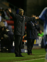 WIGAN, ENGLAND - TUESDAY, JANUARY 10th, 2006: Arsenal's manager Arsene Wenger  during the League Cup match against Wigan Athletic at the JJB Stadium. (Pic by Chris Brunskill/Propaganda)
