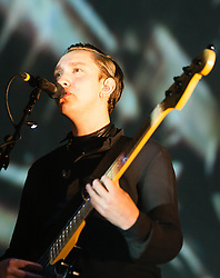 "© Licensed to London News Pictures. 16/12/2012. London, UK.   Oliver Sim of The XX performing live at O2 Academy Brixton. The xx are an English indie band, formed in London in 2008.  In 2010, the band won the Mercury Music Prize for their debut album, xx.  The band is composed of Romy Madley Croft (vocals, guitar),  Oliver Sim (vocalis, bass) , and .Jamie ""Jamie XX"" Smith (percussion, producer). Photo credit : Richard Isaac/LNP"