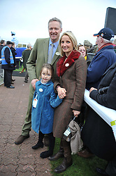 RORY & TESSA BREMNER and their daughter LILA BREMNER at the Hennessy Gold Cup at Newbury Racecourse, Berkshire on 26th November 2011.