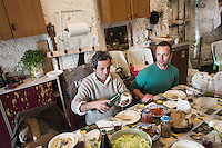 CETARA, ITALY - 10 March 2014: (L-R) Ciro Caliendro, a 55 years old peasant, and Gianpietro Pinto, a 37 years old local coordinator of Genuino Clandestino, have lunch with local products in the farmhouse of Antonio Polverino, a 64 years old peasant who lives and works in Cetara, a village of fishermans in the Amalfi Coast, Italy, on March 10th 2014.<br /> Antonio Polverino was interviewed by Daniele De Michele, aka Donpasta, a DJ-economist with a passion for gastronomy.