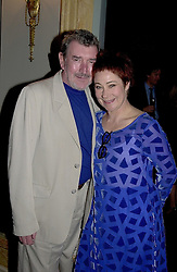 Actress ZOE WANNAMAKER and her husband MR GAWN <br /> GRAINGER, at a party in London on 27th April 2000.ODC 57