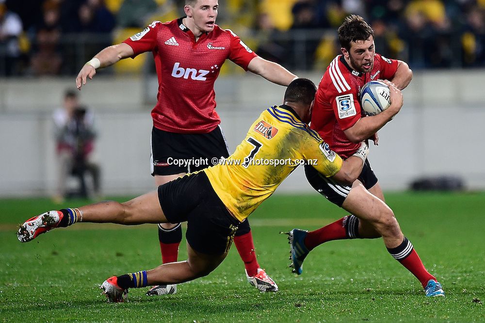 Tom Taylor of the Crusaders is tackled by Ardie Savea of the Hurricanes during the Super Rugby - Hurricanes v  Crusaders rugby match at the Westpac Stadium in Wellington, New Zealand on the 28th of June 2014. Photo: Marty Melville/www.Photosport.co.nz
