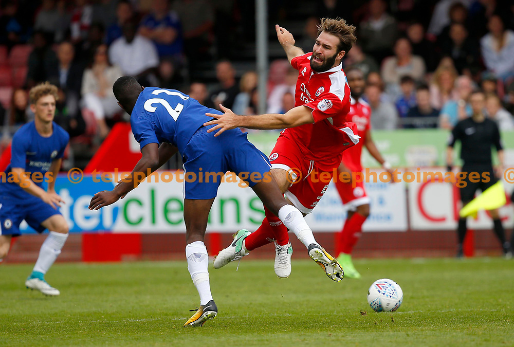 Joe McNerney of Crawley challenges Martel Tyler-Crosdale of Chelsea during the pre season friendly between Crawley Town and Chelsea XI at the Checkatrade Stadium in Crawley. 15 Jul 2017