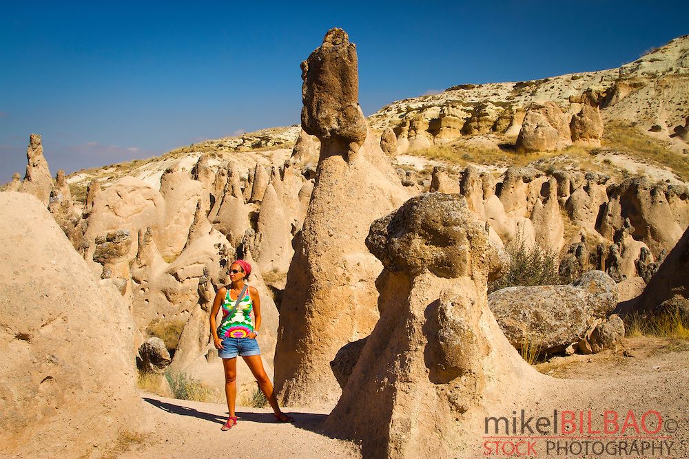 Woman and fairy chimneys in Devrent Valley.Cappadocia, Turkey.