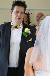 Visually impaired bride and groom saying their vows.