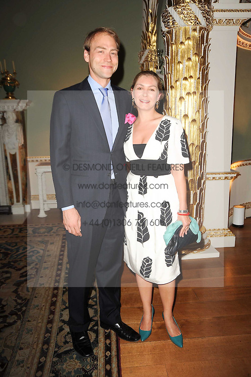 KASPAR PFLUEGER and his wife THERESA BERNHEIMER at a party to celebrate the 250th anniversary of the Colnaghi Gallery held at Spencer House, London on 1st July 2010.