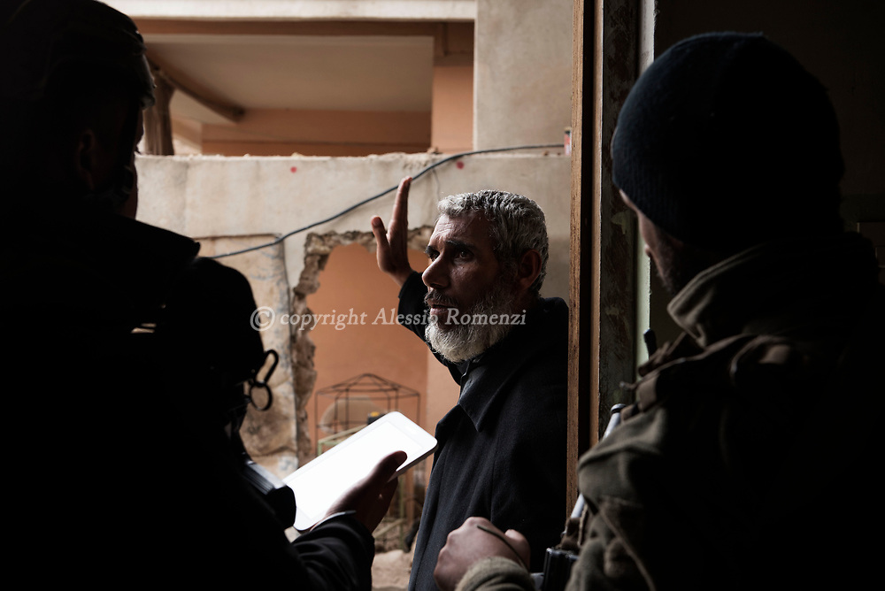 Iraq, Mosul: A Mosul resident is questioned by Golden Division members to figure out ISIS fighters presence in a newly liberated area in west Mosul. Alessio Romenzi