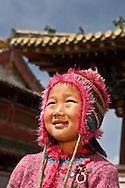Mongolia. little girl in front of  Erdene Zuu temple   Hakhorin - Mongolia  Children fashion ,  Deux par Deux collection / petite fille devant le temple de Erdene Zuu  Karakorum - Mongolie Mode enfant  / 17B